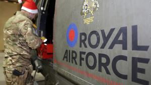 An RAF groundcrew member services a Puma Mk 2 helicopter before another sortie in Afghanistan (MoD/PA)