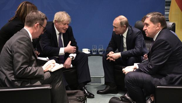 Prime Minister Boris Johnson and Russian President Vladimir Putin talk to each other during their meeting on the sidelines of a conference on Libya in Berlin (Alexei Nikolsky, Sputnik, Kremlin Pool Photo via AP)