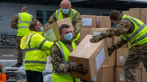 The supplies were unloaded by the military (Tomos Terfel/PA)