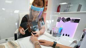 Beautician Alex Smith does a customer's nails at Madame Beauty salon in Chirton, North Tyneside (Owen Humphreys/PA)