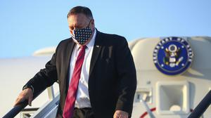 US Secretary of State Mike Pompeo steps from his plane upon arrival in London (Hannah McKay/Pool Photo via AP)