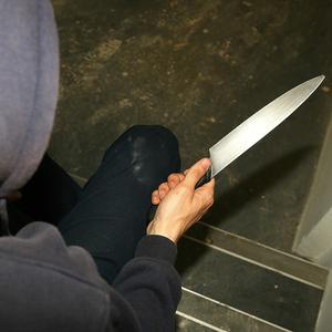 """A teenager with a """"formidable"""" criminal record who hijacked a woman's car at knifepoint as she tried to park has been handed a five-year jail sentence. Picture posed"""