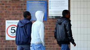 A group of asylum seekers arrive at the Grand Burstin Hotel in Folkestone, Kent, last year where they were moved to ease overcrowding