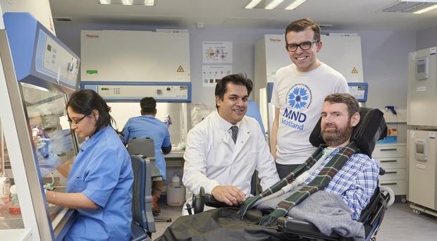 Suvankar Pal, Lawrence Cowan and Euan MacDonald, who is living with MND and co-founder of the Euan MacDonald Centre for MND Research (maverickphotoagency.com/PA)