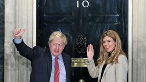 Prime Minister Boris Johnson and his girlfriend Carrie Symonds arrive in Downing Street after the Conservative Party was returned to power (Yui Mok/PA)