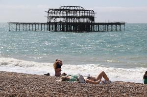 People enjoy the hot weather further along the south coast in Brighton (Steve Parsons/PA)
