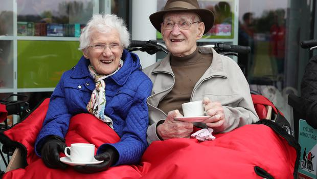 Mary Duncan, 90, and Jim Taylor, 96, enjoy a cup of tea in their trishaw (Andrew Milligan/PA)