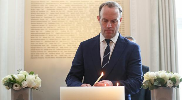 Dominic Raab lights a candle at a memorial event for the passengers of the Ukrainian International Airlines flight that crashed in Iran (Jonathan Brady/PA)