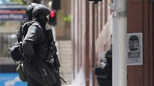 Police at the scene of a siege at Martin Place in the central business district of Sydney, Australia (AP)
