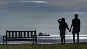 The public are being reminded to practise social distancing (Owen Humphreys/PA)