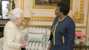 The Queen, shown receiving Barbados Governor-General Dame Sandra Mason at Windsor Castle, would cease to be the head of state of the Caribbean country if it proceeds with its plan (Steve Parsons/PA)