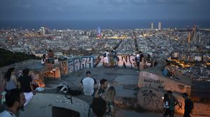 Dusk in Barcelona – Britain is advising people not to travel to Spain and has removed the country from the list of safe places to visit following a surge of Covid-19 cases (AP Photo/Felipe Dana)