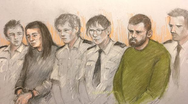 Sketch of Sarah Barrass and Brandon Machin flanked by security staff at Sheffield Crown Court (Elizabeth Cook/PA)