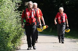 Rescue workers at the scene of the search at Odney Weir near Cookham (Jonathan Brady/PA)