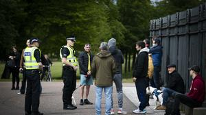Police attend as members of the public gather in Glasgow Green to protest against the coronavirus lockdown restrictions (Jane Barlow/PA)