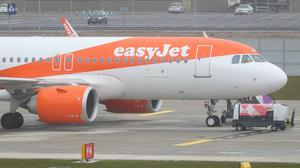 EasyJet has said it expects to post narrowed half-year underlying losses of up to £205m as it insisted cost-cutting actions mean it is 'well positioned' to weather a prolonged grounding of aircraft due to coronavirus (Jonathan Brady/PA)