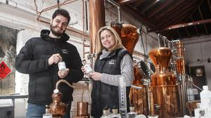 Distillery co-founder Sally Green with production manager Andrea Natiello after hearing the Treasury will not demand duty on alcohol in hand sanitisers (Harrogate Tipple/PA)