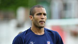 Former footballer Clarke Carlisle is due to appear in court in London next month