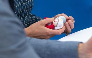 The Duchess of Cambridge holds NHS Knitted Angels (Joe Giddens/PA)
