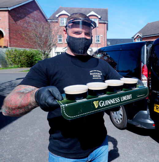 Barman Harry McKeaveney from the Hatfield bar delivery service delivers pints of draft Guinness around Belfast.