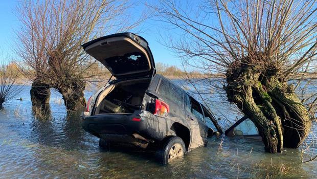 One of two abandoned vehicles off the A1101 on the Norfolk-Cambridgeshire border (Fenland Police/PA)