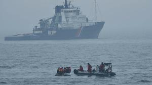 Ten migrants who were found on a boat off Boulogne-sur-Mer by French authorities (Cormoran/Marine Nationale/PA).