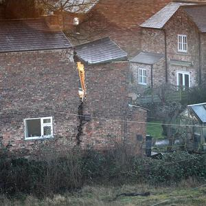 A view of a large crack on a house in Magadalen's Close, Ripon, after a 25ft wide sinkhole opened up in the street