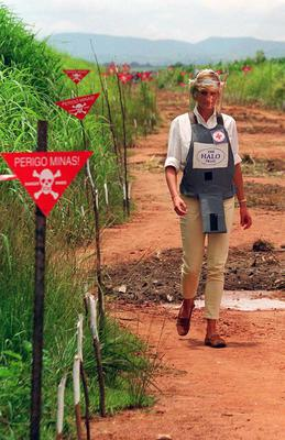 In 1997, Diana toured a minefield in Angola in body armour to learn about the carnage military munitions can cause (John Stillwell/PA)