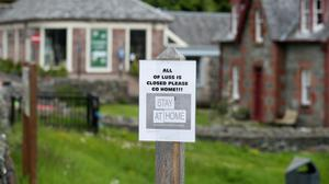 A sign in the village of Luss at Loch Lomond as the lockdown continues (Andrew Milligan/PA)