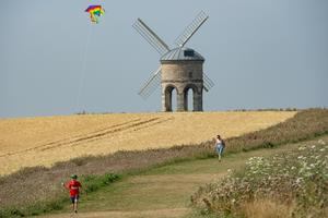 Jack, 10, plays with his kite as he enjoys the hot weather by Chesterton Windmill, Warwickshire (Jacob King/PA)