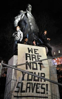 A group of students protested next to the statue against the rise of university tuition fees in 2010 (John Stillwell/PA)