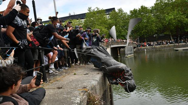 The Edward Colston statue was thrown into Bristol Harbour after being toppled (Ben Birchall/PA)