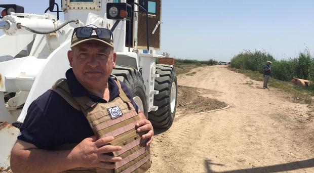 Frank Philip at work clearing landmines in Iraq (DFID/PA)
