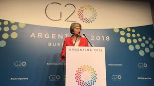 Theresa May gives a press conference in Buenos Aires (Andrew Woodcock/PA)