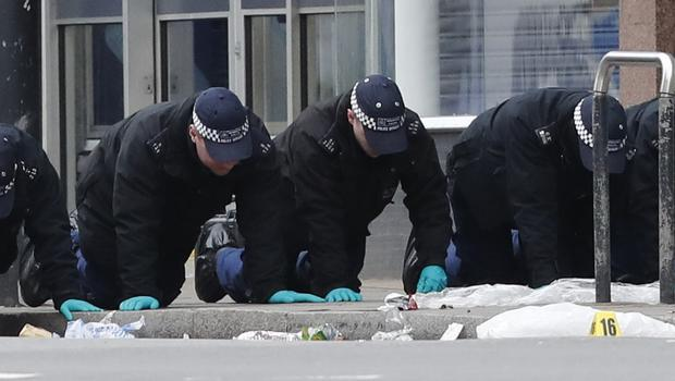 Police conduct a fingertip search following the terror attack in Streatham (Aaron Chown/PA)