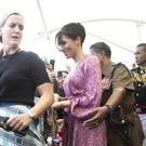 Meghan being escorted through a market in Fiji (Dominic Lipinski/PA)