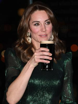 The Duchess of Cambridge holds a pint of Guinness during a reception hosted by the British Ambassador to Ireland at the Gravity Bar, Guinness Storehouse, Dublin, during a three day visit to the Republic of Ireland with her husband the Duke of Cambridge.