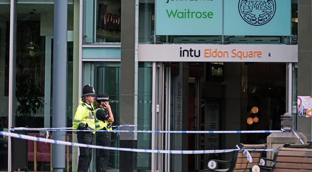 Police outside a branch of Greggs near Old Eldon Square, Newcastle, where 52-year-old lawyer Peter Duncan was stabbed to death (Owen Humphreys/PA)