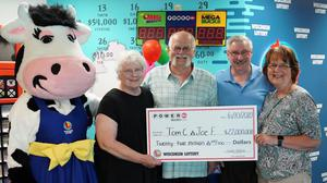 Lottery winners Tom Cook, Joe Feeney and their wives (Wisconsin Lottery/PA)
