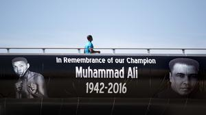 A footbridge decorated with a memorial banner to Muhammad Ali in Louisville, Kentucky (AP)