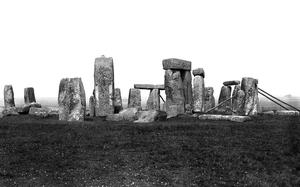 Stonehenge whilst its sarsen stones were buttressed with timber to prevent their collapse in 1913 (PA)