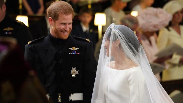 Prince Harry looks at his bride as she arrives (Jonathan Brady/PA)