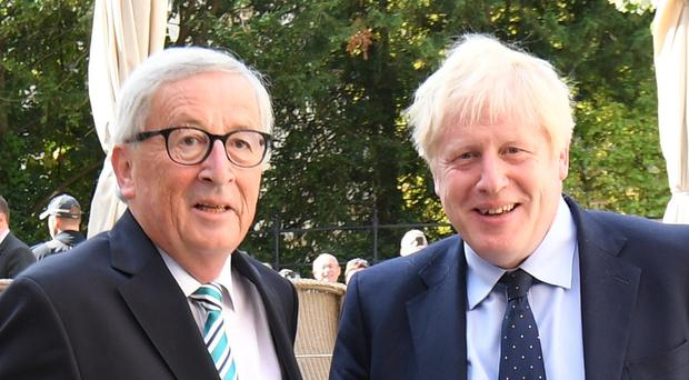 Prime Minister Boris Johnson is greeted by European Commission President Jean-Claude Juncker, outside Le Bouquet Garni restaurant in Luxembourg (Stefan Rousseau/PA)
