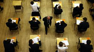 A general view of pupils sitting an exam. A majority of teachers say students who are due to sit exams next year following months of school closures are not on track to get the results they are capable of, a survey suggests (David Jones/PA)