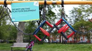 Activity equipment in the children's playground area of a park in London is closed off, as the UK continues in lockdown to help curb the spread of the coronavirus (Yui Mok/PA)