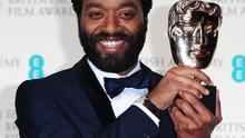 Chiwetel Ejiofor with the Best Actor award for 12 Years A Slave, at The EE British Academy Film Awards 2014