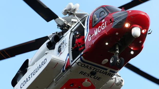 A Coastguard helicopter has been searching for missing walkers (Andrew Milligan/PA)