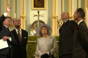 The Queen and the Duke of Edinburgh visiting the Chapel of the Savoy, which is part of the Duchy of Lancaster estate, in London in 2003 (Chris Young/PA)