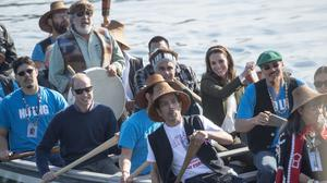 The Duke and Duchess of Cambridge help paddle their canoe to the Haida Heritage Centre and Museum