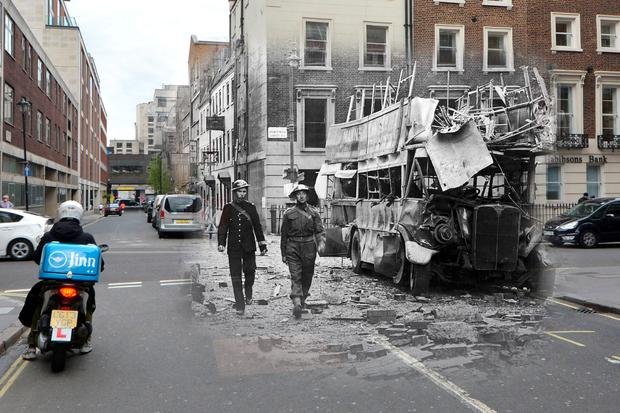 A police officer and a soldier inspect the aftermath of a German air raid at Portman Street on September 19 of the same year